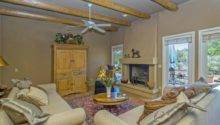 Southwestern Living Room Stone Fireplace Terracotta Tile Floors