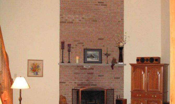 Boring Two Story Brick Face Fireplace