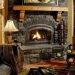 Elegant Stone Fireplace Inserted Glass Wall
