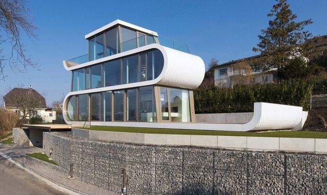 Glass Fronted House Shaped Like Ribbon Near Lake Zurich