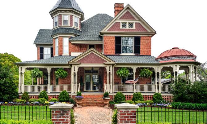 Large Red Brick White Trim Victorian House Wrap Around