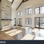 Living Room Two Story Stone Fireplace