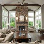 Love Two Story Stone Fireplace Surrounded Windows Also