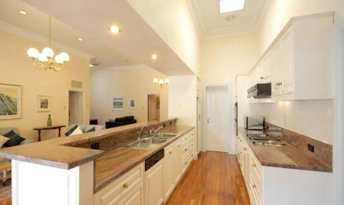 Modern Galley Kitchen Design Using Floorboards