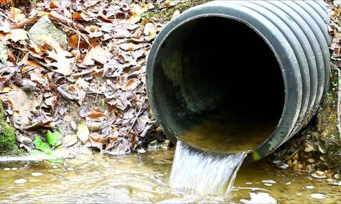 Old Plastic Storm Drain Pipe Water Flowing Out