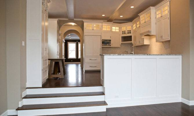 Open Concept Kitchen Lets Light Travel Through Opening Space