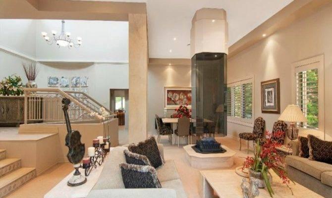 Split Level Living Room Using Beige Colours Carpet Louvre