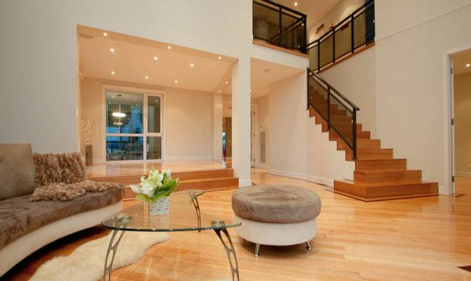 Split Level Living Room Using Black Colours Floorboards Floor