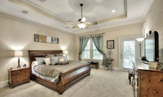 Striking Master Bedroom Suite Foot Tray Ceiling Closet
