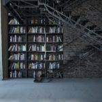 Stunning Floor Ceiling Bookshelf Spans Wall Behind Old