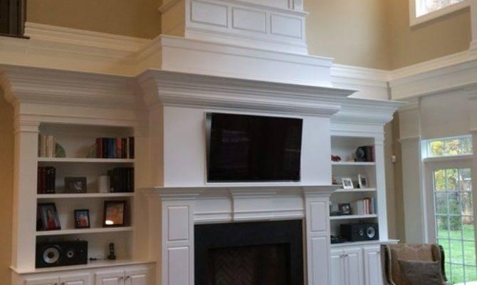 Two Story Fireplace Built Bookshelves