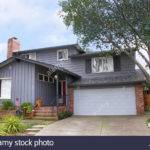 Two Story Ranch Style House Gray Wood Siding Red