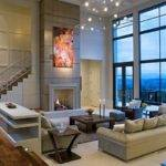 Ultra Modern Two Story Living Room Stands Below Glass Facade