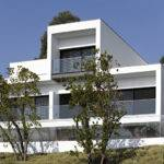 White Concrete Three Storey House Pitagoras