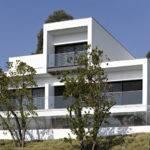 White Concrete Three Storey House Pitagoras